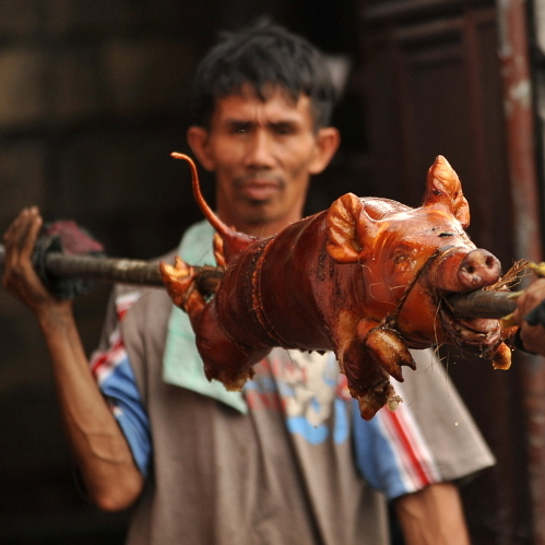 """Lechon"", or roasted pig, is often served at Philippine festivities, especially during Christmas and New Year celebrations."