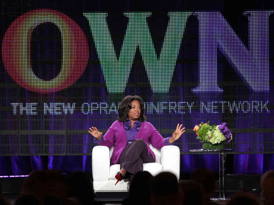 Oprah Winfrey talks to reporters during a press tour that f