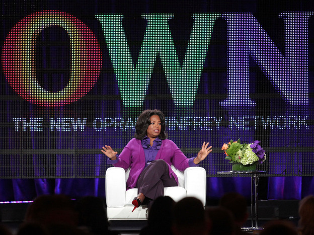 Oprah Winfrey talks to reporters during a press tour that followed the launch of her cable network, OWN, in January.