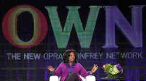 Oprah Winfrey talks to reporters during a press tour that followed the launch of her cable network, OWN, in