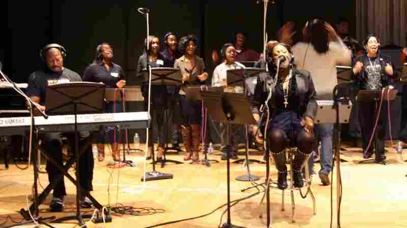Sounds of Blackness founder Gary Hines (left) and vocalist Jamecia Bennett, perform with the Howard University Gospel Choir at NPR headquarters in Washington, D.C.