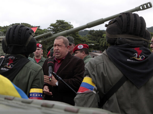 A handout picture released by the Venezuelan presidency, shows  President Hugo Chávez speaking with members of the Army during a military ceremony in Caracas on Wednesday.