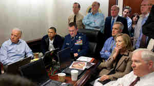 President Obama, Vice President Joe Biden and members of his National Security team receive an update on the mission against Osama bin Laden in the Situation Room of the White House. A classified document seen in this photograph has been obscured.