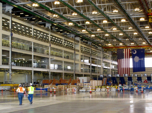 Workers in Boeing's new $750 million final assembly plant in North Charleston, S.C. At the plant's ribbon-cutting ceremony in June, Rep. James Clyburn called the newly constructed facility a game changer for the state's workforce.