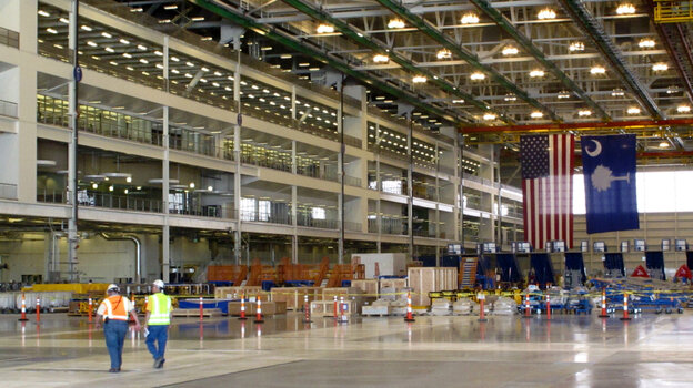 Workers in Boeing's new $750 million final assembly plant in N