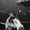 Bill Russell (6) of the Boston Celtics lays up a shot over the heads of John Kerr (10) and Lee Shaffer (22) of the Syracuse Nationals in their NBA game at the Boston Garden, March 13, 1962. Celts won, 142-110. (AP Photo/Peter J. Carroll)