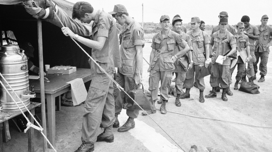 U.S. soldiers at Long Binh base, northeast of Saigon, line up to give urine samples at a heroin detection center in June 1971, before departing for the U.S. (AP)