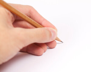 Left-handed person writing.