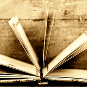 an open book in sepia colors and wooden background