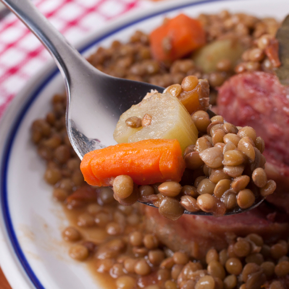 Italians munch on coin-shaped lentils with cotechino, a pork sausage that symbolizes the fat of the land.