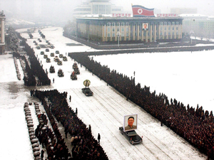 This image, released by the North Korean Central News Agency, was taken within seconds of the one above. An analysis shows that it was digitally altered, removing the cluster of men on the left edge and enhancing the perfect line of mourners.