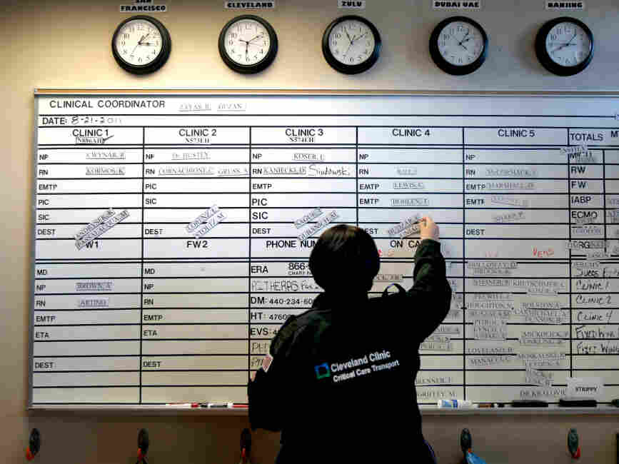 Rachel Zayas, a registered nurse, sets up the shift board for the night shift at the Cleveland Cli