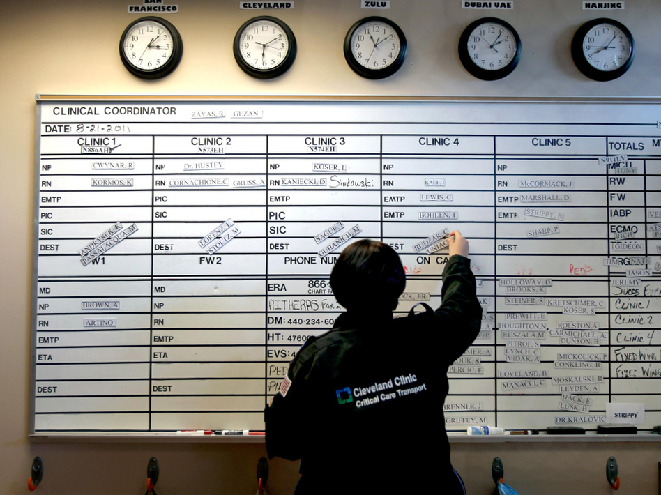 Rachel Zayas, a registered nurse, sets up the shift board for the night shift at the Cleveland Clinic.