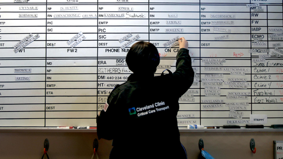 Rachel Zayas, a registered nurse, sets up the shift board for the night shift at the Cleveland Clinic. (The Plain Dealer /Landov)