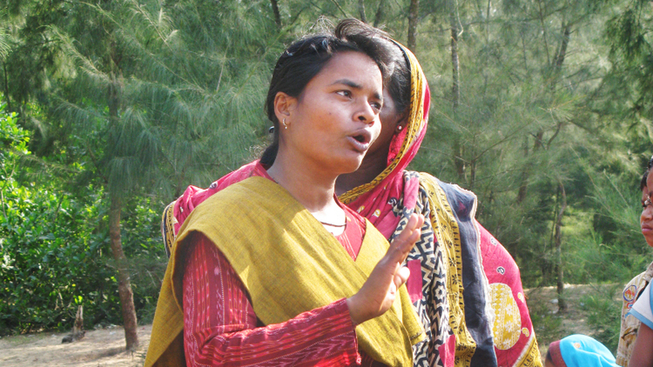 Activist Manorama Khatua speaks to a group of protesters on land that a steel company wants for a new mill in the southeastern state of Orissa, India, in October.