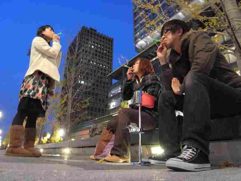 Mina Abe (center) and Kota Osabe (right) are trying to promote blowing bubbles as an alternative to cigarette smoking in Japan.