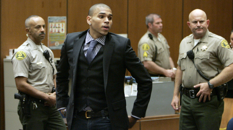 Chris Brown prepares to leave court after a hearing in Los Angeles in November 2009, to offer a judge his first progress report since being sentenced for beating ex-girlfriend Rihanna earlier that year.