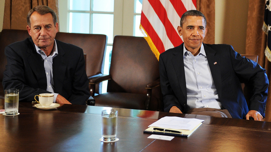 "House Speaker John Boehner, R-Ohio, and President Obama at the White House on a Saturday in July, a day after Obama told reporters he had been ""left at the altar"" by Boehner.  (AFP/Getty Images)"