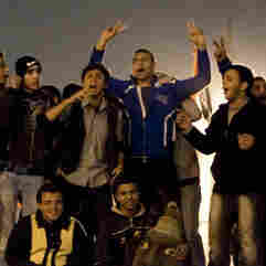 Egyptian anti-government protesters celebrate at Tahrir Square in Cairo on February 11, 2011 after President Hosni Mubarak stepped down after three decades of autocratic rule and handed power to a junta of senior military commanders.
