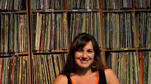 Heather Browne, who runs the music blog I Am Fuel You Are Friends, stands before her formidable record collection. She and WXPN's Bruce Warren share their picks for artists to watch in 2012.