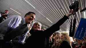 Republican presidential contender Mitt Romney campaigning in Ames, Iowa, on Thursday (Dec. 29, 2011).
