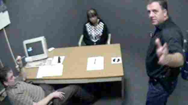 A screen shot of video footage attained by WBUR shows Worcester Police Sgt. Kevin Pageau (right) and Detective John Doherty as they interrogate Nga Truong, then 16, after the 2008 death of her baby boy.