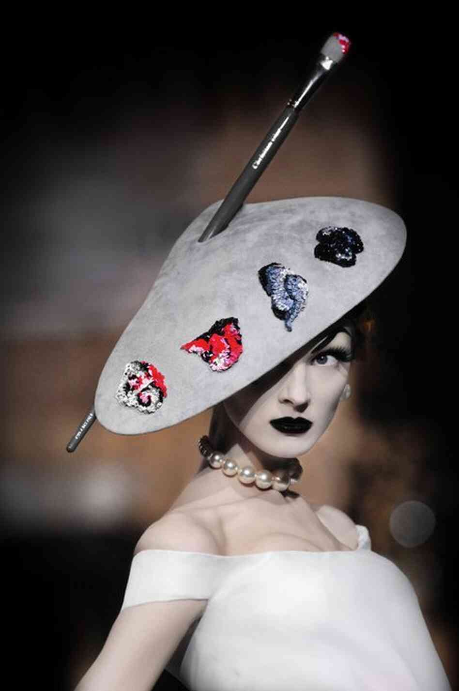A Stephen Jones hat inspired by the fashion illustrator Rene Gruau, for Christian Dior Haute Couture, autumn/winter 2007-2008.