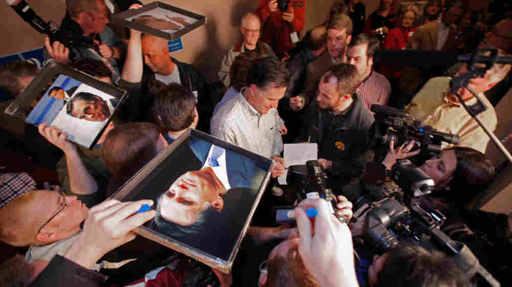 Supporters seek autographs from Mitt Romney during a campaign event at the Family Table Restaurant Saturday in Le Mars, Iowa.