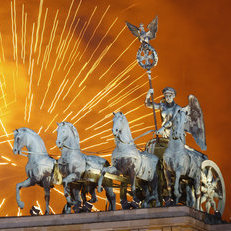 Fireworks explode over the Quadriga statue atop the Brandenburg Gate on New Year's Eve on January 1, 2012 in Berlin, Germany.