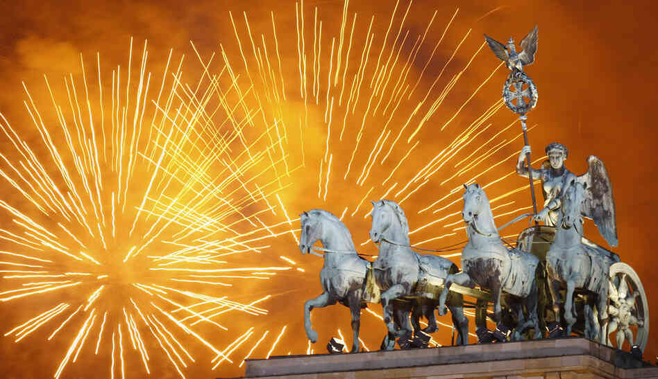 Fireworks explode over the Quadriga statue atop the Brandenburg Gate on Jan. 1 in Berlin.