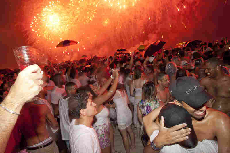 An estimated 2 million people attended the annual beach party in Rio De Janeiro, Brazil, to bring in 2012.