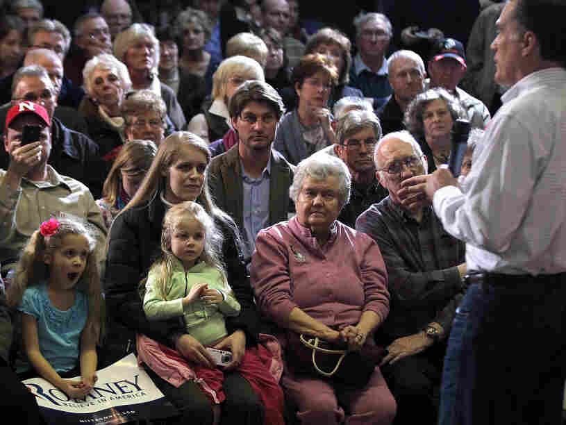 Former Massachusetts Gov. Mitt Romney campaigns Sunday in Council Bluffs, Iowa.