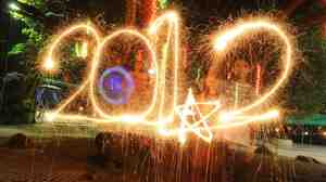 Filipino youths bring in the New Year with sparklers at a public park in Manila.