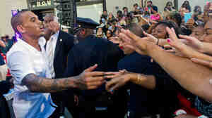 Singer Chris Brown meets with fans after performing on NBC's Today show in New York in July. Two years after his arrest for assaulting his then-girlfriend Rihanna, many of his fans — mostly teenage girls — blame Rihanna for the incident.