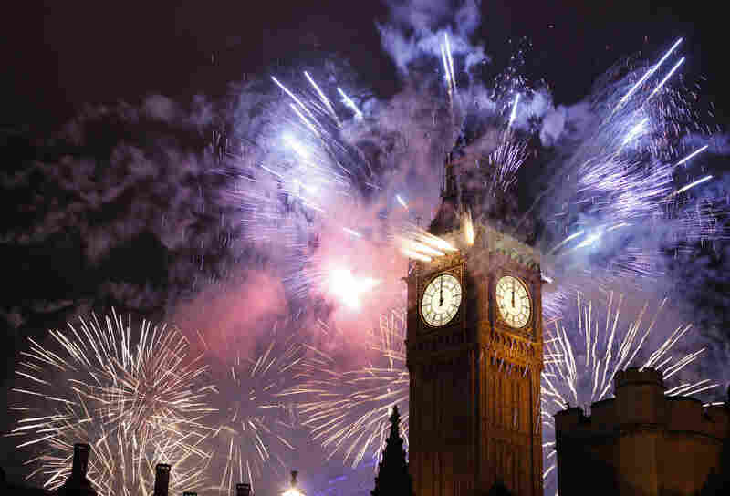 London celebrates the arrival of the new year with fireworks over the Houses of Parliament, including St. Stephen's Tower.
