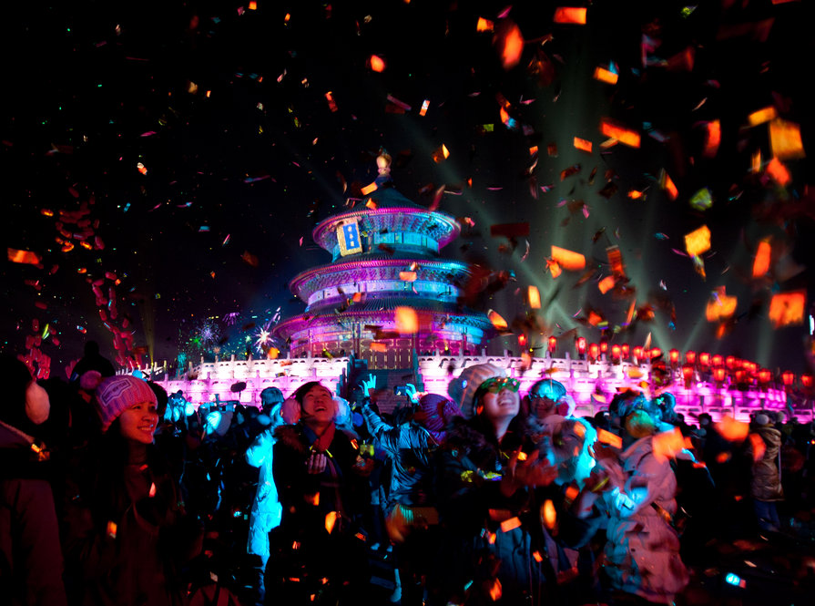 Visitors are  showered by confetti during a light show at the Temple of Heaven in Beijing Jan. 1.