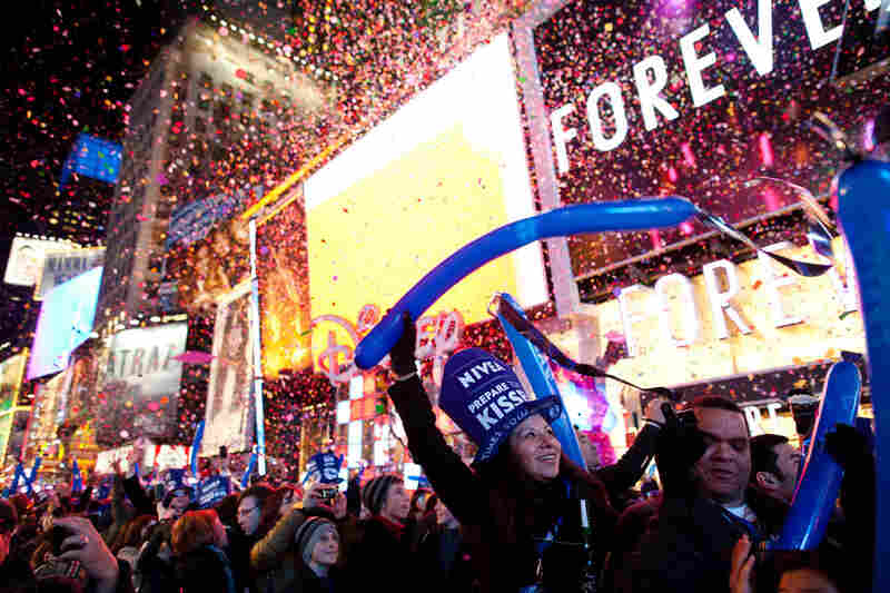 Revelers cheer at midnight in Times Square in New York. Some began camping out Saturday morning.