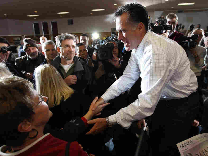 Former Massachusetts Gov. Mitt Romney greets voters after speaking at the Mississippi Valley Fairgrounds on Wednesday in Davenport, Iowa.