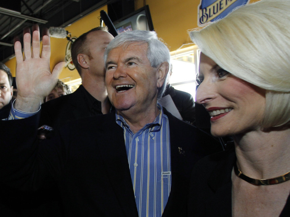 Former House speaker Newt Gingrich and wife, Callista, campaigned on New Year's Day in Ames, Iowa.  (Eric Gay/AP)