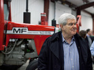 Gingrich with one of the many pieces of farm equipment he encountered on a last-minute campaign swing through Iowa. This tractor was on display at the Heartland Acres Agribition Center on Monday in Independence, Iowa.