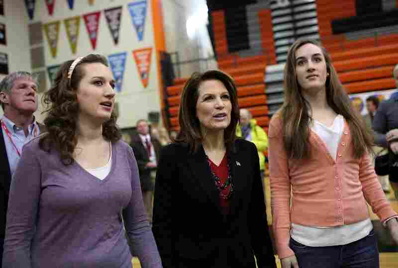 Michele Bachmann walks with her daughters Caroline (right) and Elise before an event at Valley High School in West Des Moines.