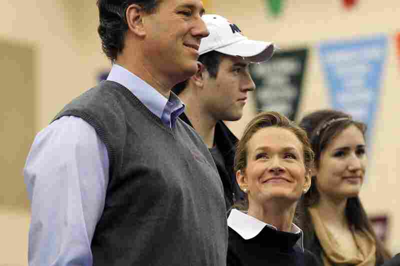 "Karen Santorum looks up at her husband, Rick Santorum, during a ""Rock the Caucus"" event in West Des Moines."