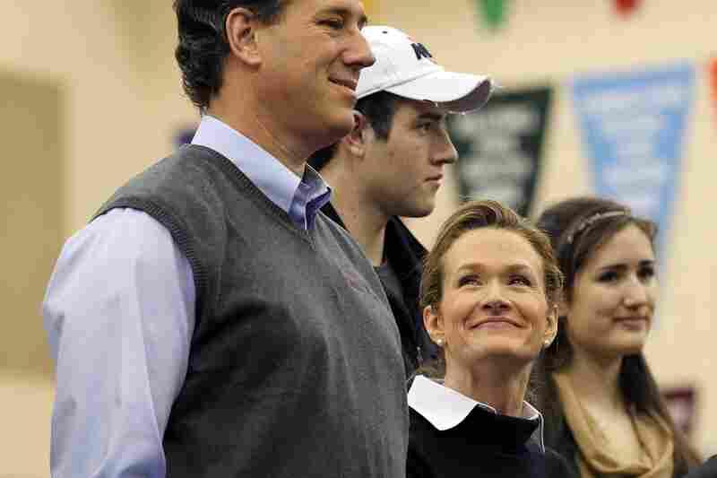 "Karen Santorum looks up at her husband, Rick Santorum, during a ""Rock the Caucus"" event in West Des Moines."