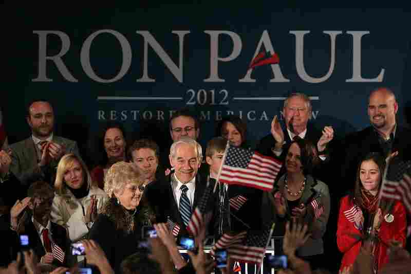Ron Paul (center) and his wife, Carol, greet supporters during a rally in Ankeny.