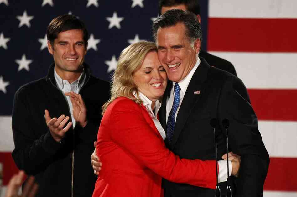 Mitt Romney hugs his wife, Ann, in Des Moines, Iowa, on Tuesday.