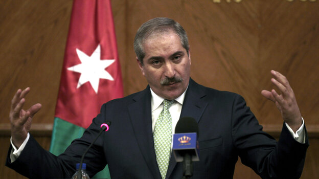 """Jordanian Foreign Minister Nasser Judeh speaks during a press conference at the foreign ministry in Amman on Tuesday. Judeh said that Israeli and Palestinian negotiators held """"positive"""" talks."""