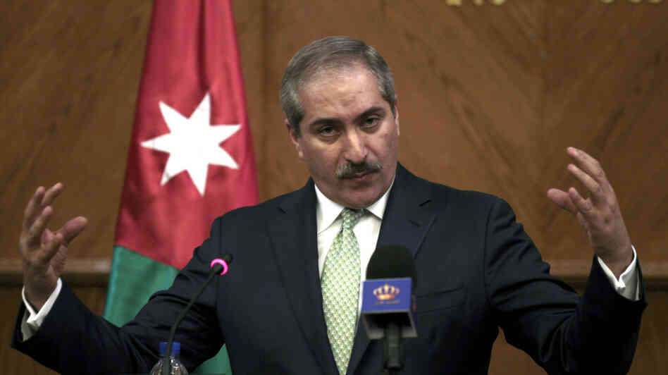 "Jordanian Foreign Minister Nasser Judeh speaks during a press conference at the foreign ministry in Amman on Tuesday. Judeh said that Israeli and Palestinian negotiators held ""positive"" talks."
