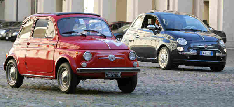 An original Fiat 500 car (left) is seen in Rome next to its newer version, which was introduced in 2007.
