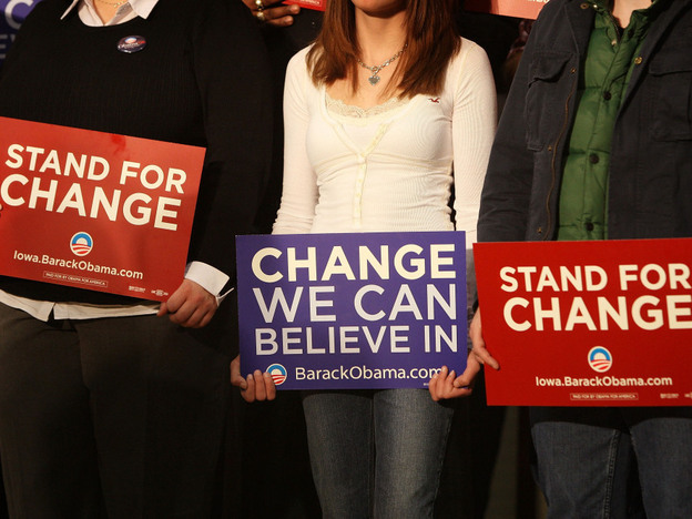 Supporters of Barack Obama hold signs as they listen to the then-candidate speak at an elementary school in Iowa in 2007. Crucial to his 2008 election, many young people have since grown disenchanted with the president.