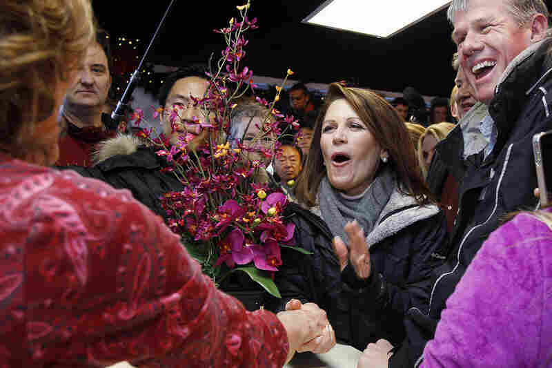 Rep. Michele Bachmann shakes hands with a store owner during a campaign stop Monday in West Des Moines, Iowa.